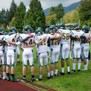 Football team huddle